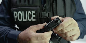 Police officer holding body camera