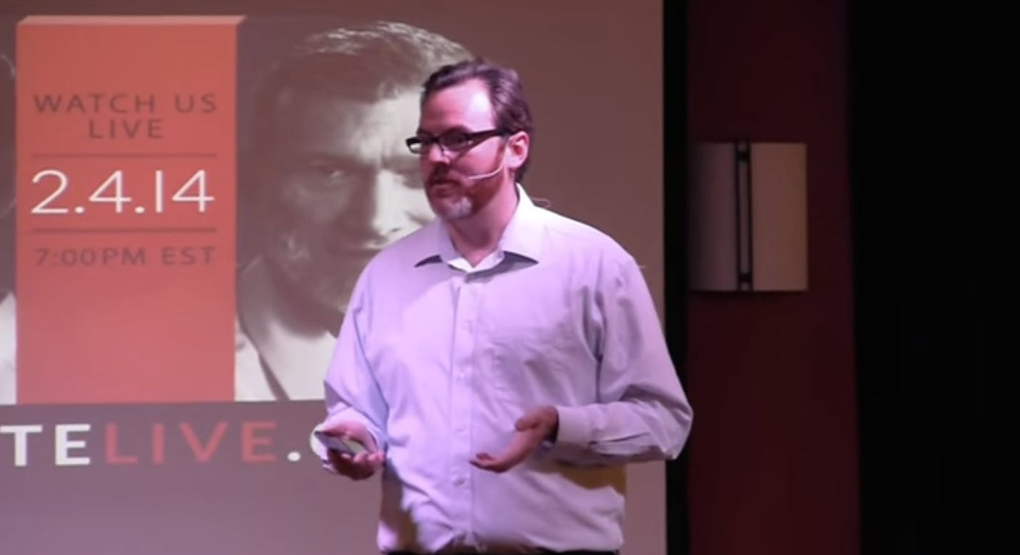 """Religious science enthusiast """"Science Mike"""" McHargue delivers a presentation on the intersection of science and faith."""