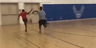 Man about to faceplant into metal door during gym race