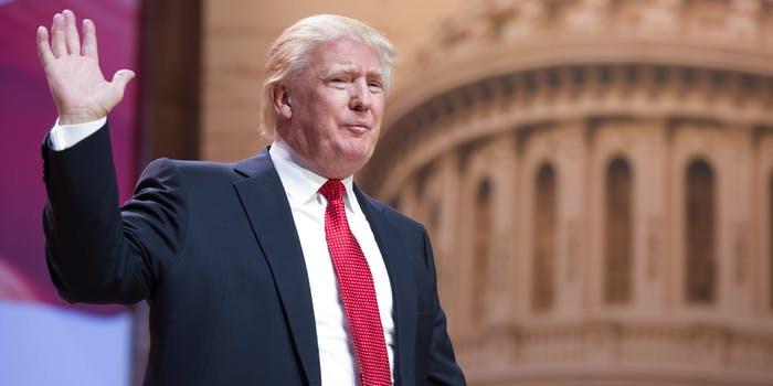 President Donald Trump Raising His Hand