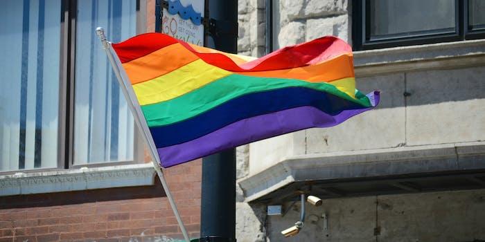 The rainbow flag represents the LGBTQ community.