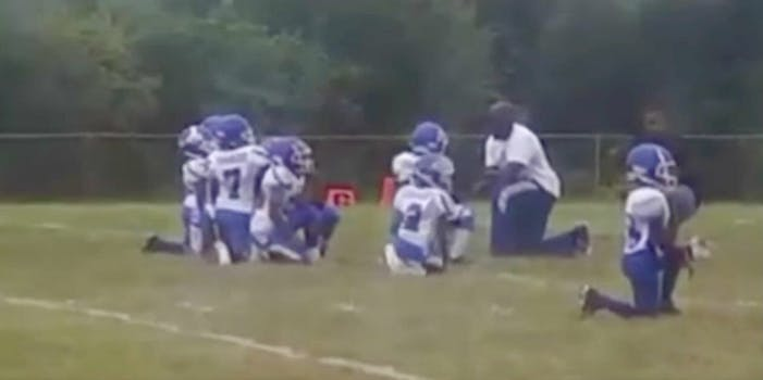 kneel for national anthem st. louis youth team
