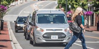Gray driverless van on road