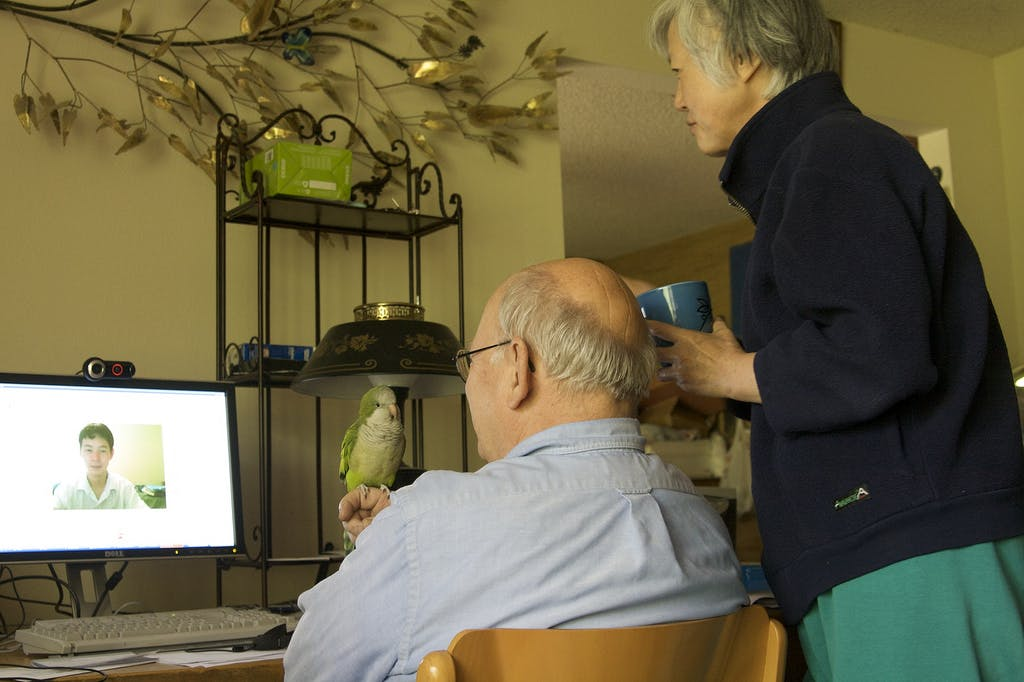 A family uses Skype to connect