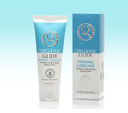 Organic glide personal lube on a two tone blue and white ombre background.