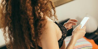 woman in bra with iphone