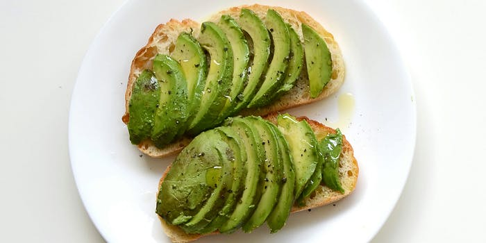 Sliced avocado on toasted bread