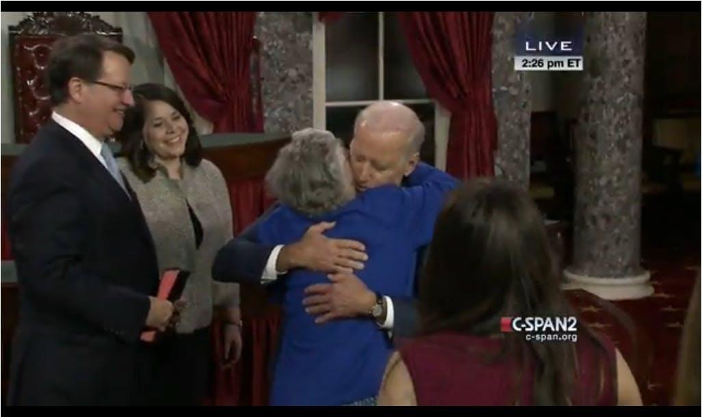 Vice President Biden hugs Sen. Gary Peters (D-Mich.)'s mother