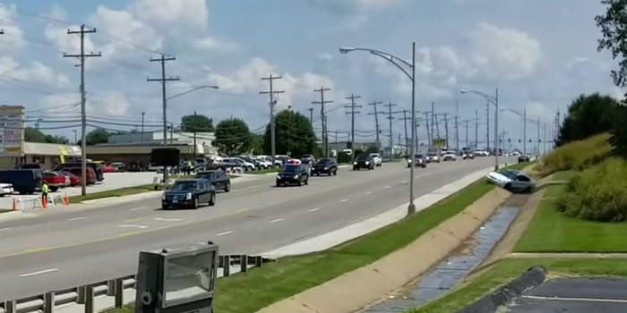 Car zooms out of woods near Trump's motorcade in Missouri