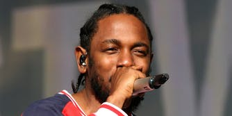 Kendrick Lamar on stage with a microphone, DAMN.