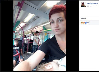A breastfeeding woman on a packed train