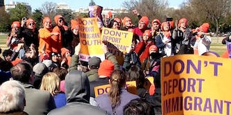 People rally at a DACA protest the day before Congress' March 5 deadline in front of the White House.