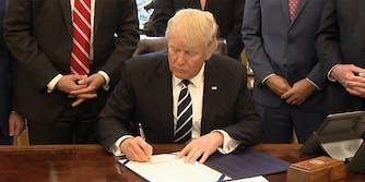 Donald Trump signing executive order