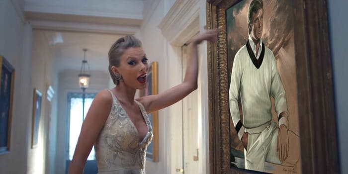 Taylor Swift pointing at painting of Donald Trump