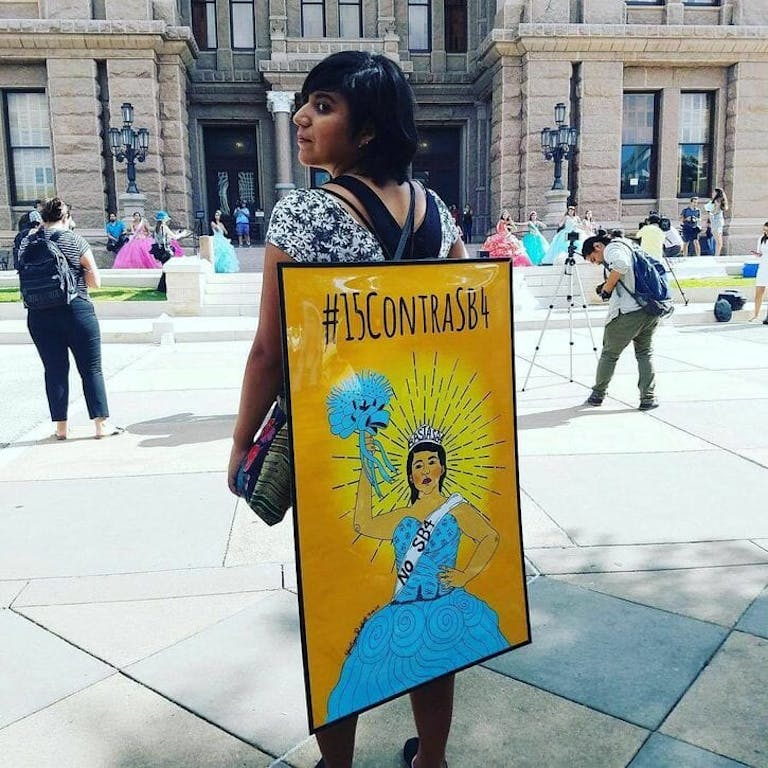 A resistance art illustration of anti-Sanctuary City resistance by Yocelyn Riojas, being worn by Riojas.