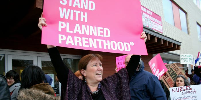 Planned Parenthood supporters protesting with signs.