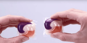 two tide pods in hands