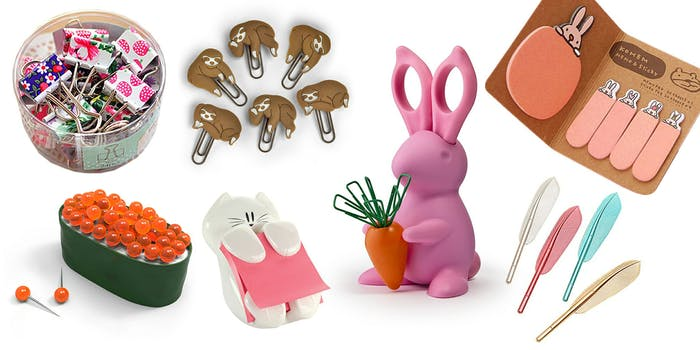 Sushi egg pushpins, cat sticky note dispenser, rabbit holding carrot paperclips, feather pens, sloth paperclips, and rabbit sticky notes.