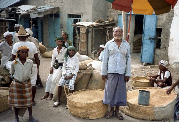 People in Al-Hudaydah, Yemen, looking like my uncles and cousins