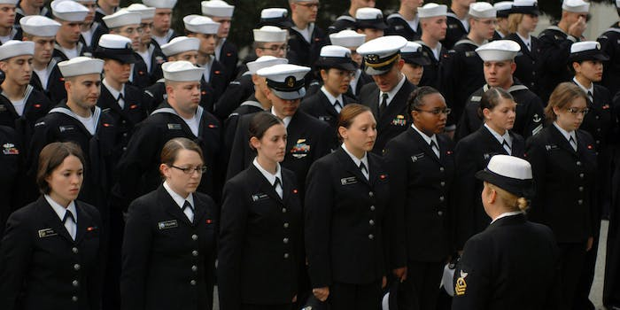 Navy personnel inspect the hairstyles of female Sailors during a personnel inspection at the Presidio of Monterey
