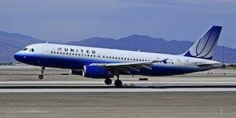 United airplane landing with brown hand streaks around back door