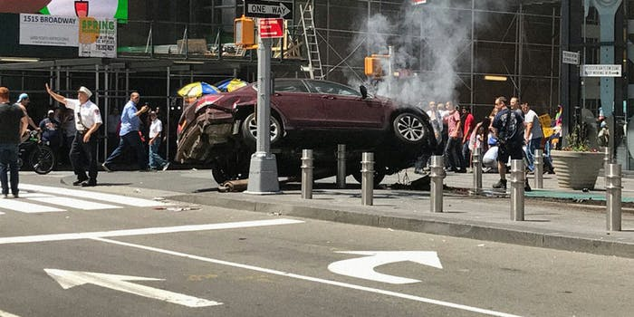 car crashed up on bollards in Times Square with pedestrians and police nearby
