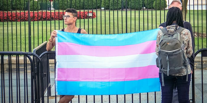 Trans activists protest the Trump administration's trans military ban announcement.