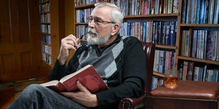 "Man smoking pipe and drinking scotch while reading ""Something Awful Vol. 1"""
