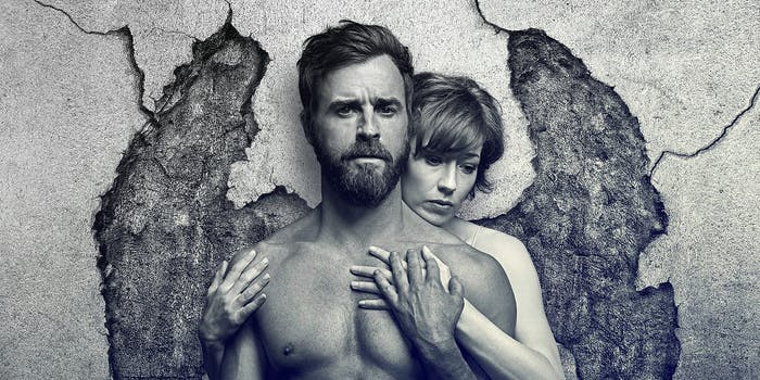 Cracks in the wall behind a couple give the appearance of wings