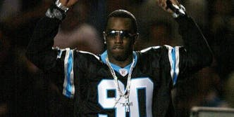 Diddy wearing a Panthers jersey.