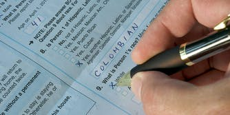 Man filling out US Census form