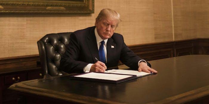 Trump signing bill at desk