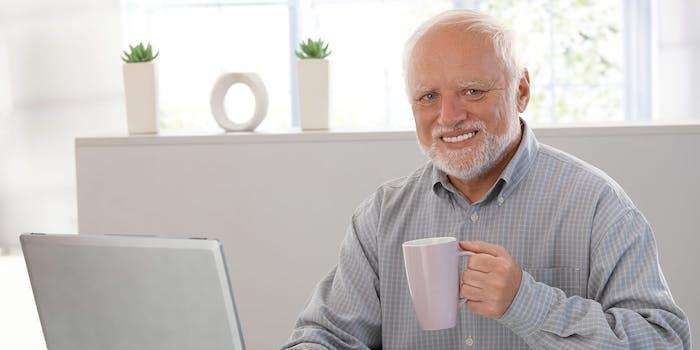 """""""Hide the Pain Harold"""" man holding mug sitting at laptop"""
