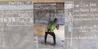 Man teaching MS Word on a chalkboard