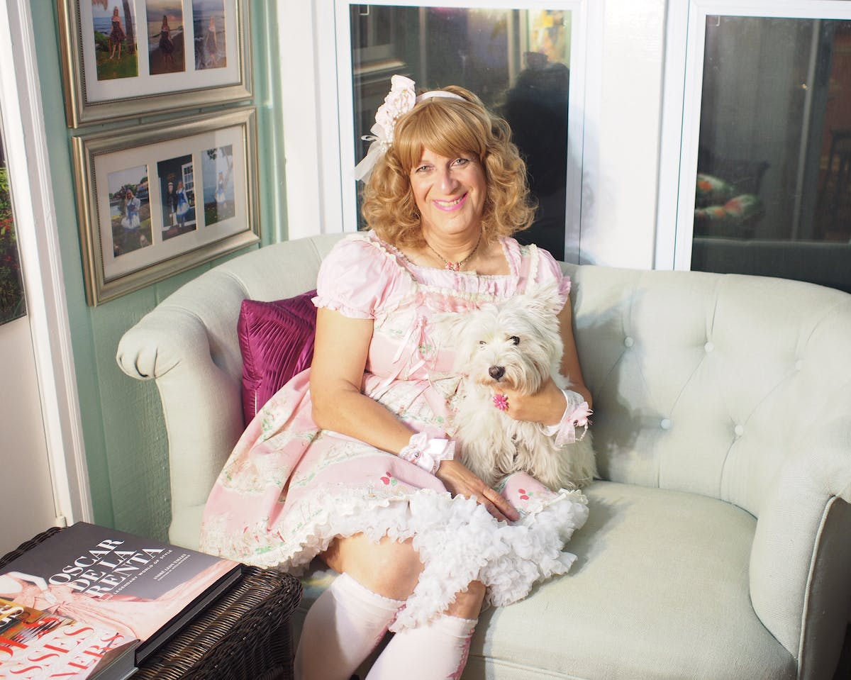 Baker in her reading nook with her dog, Sophie