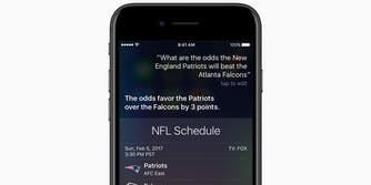 iPhone with Hey Siri and NFL stats onscreen