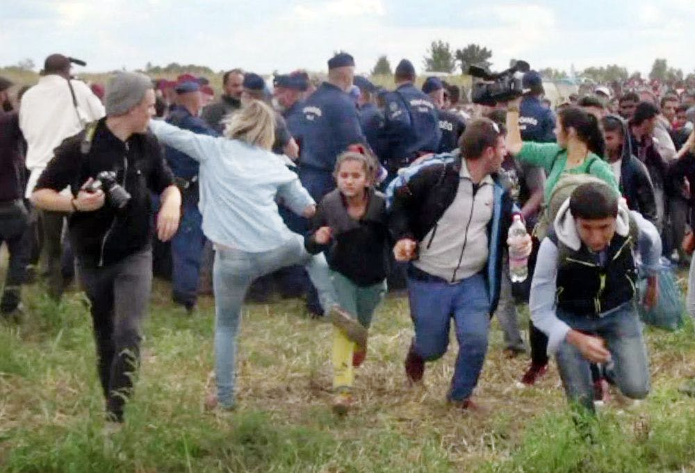 Petra Lazlo (in light blue top) was photographed kicking multiple children. —