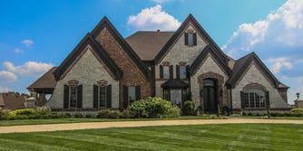 """""""McMansion"""" house with mis-matched facades and little balance."""
