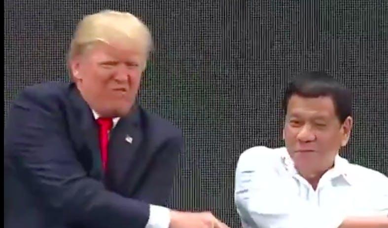donadl trump handshake asean