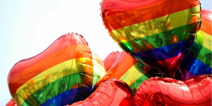 Heart-shaped rainbow gay pride balloons