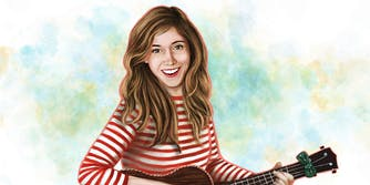 Emily Arrow holding acoustic guitar