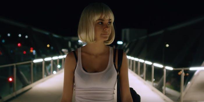 Maia Mitchell standing on bridge