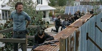 Armed people guarding a barrier on The Walking Dead