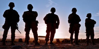 U.S. Marines against a sunset