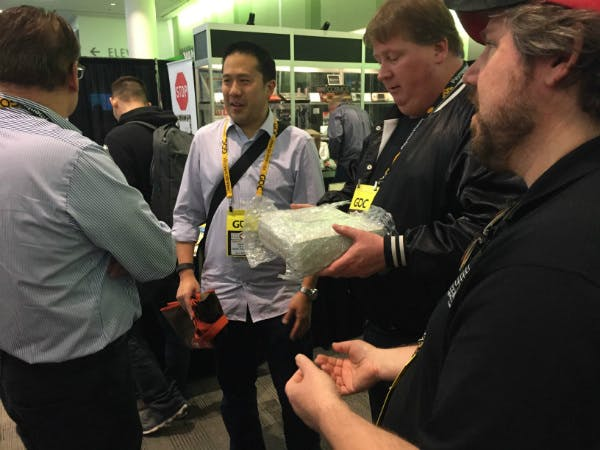 John Hardie and Joseph Santulli of the Videogame History Museum (right) receive a gift of an Atari Panther development kit.