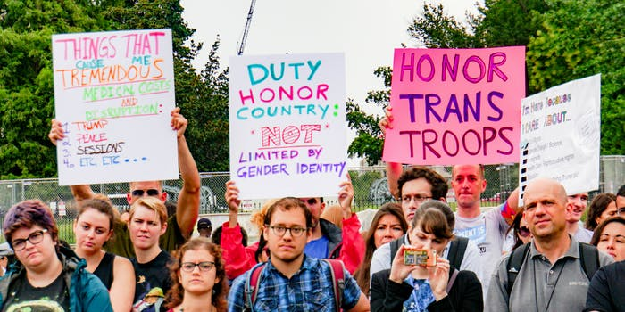 Protesters grouping outside the White House against Trump's transgender military ban.