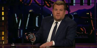 James Corden holding mug at desk
