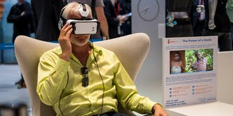 Man viewing virtual reality pitch for charity