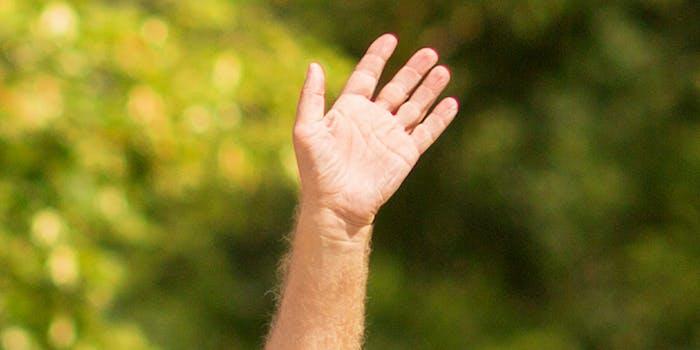 Older man waving