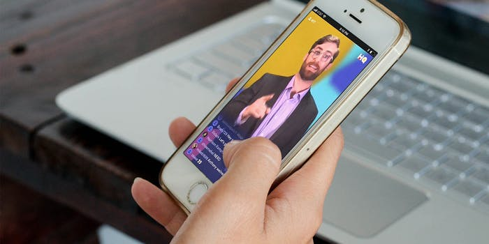 Woman using HQ Trivia app on iPhone